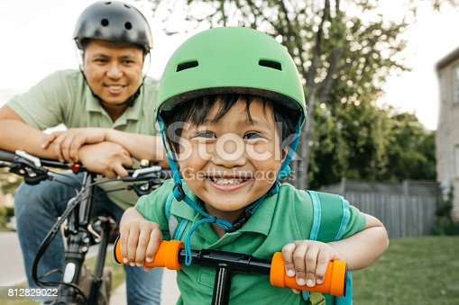 istock Father and son on bikes 812829022