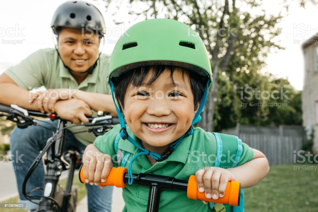 Father and son on bikes stock photo