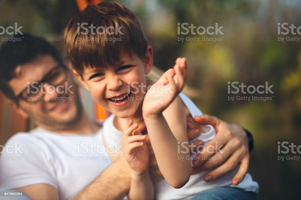 Father and son on camping stock photo