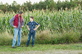 istock Father and son on family farm, in field of corn 638469226