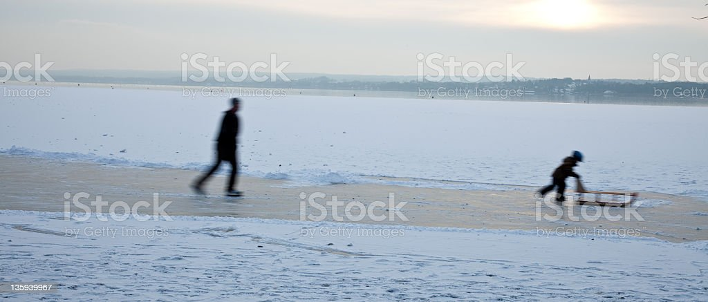 father and son on ice stock photo