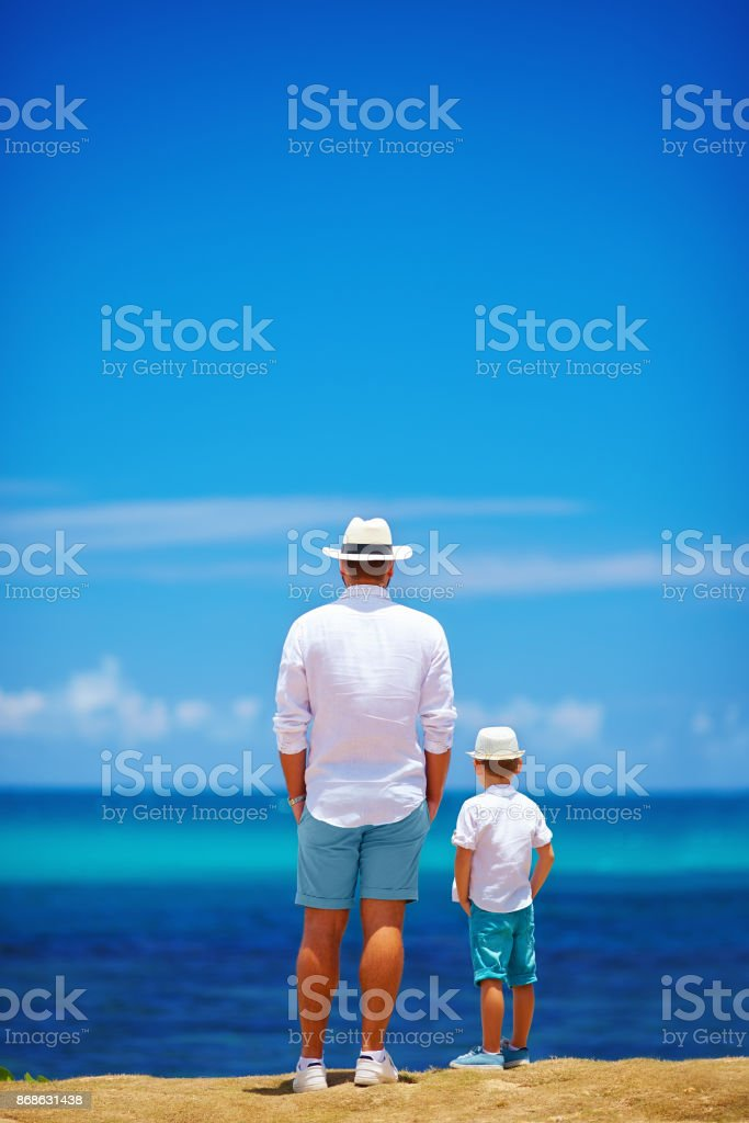 father and son on summer vacation near the seaside stock photo