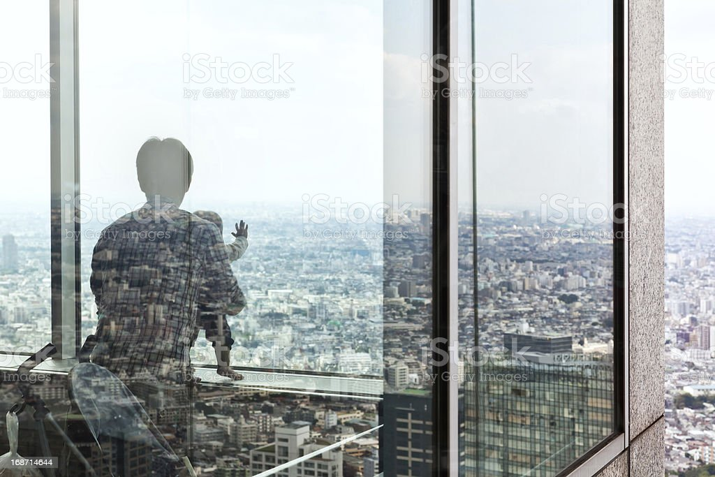 Father and Son over Tokyo royalty-free stock photo