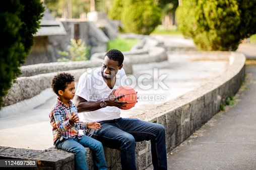 889172928istockphoto Father and son. 1124697363