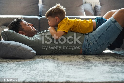 Father and son are spending time in the living room.