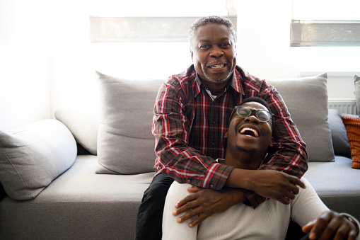 60 years old man is having a moment with his son.