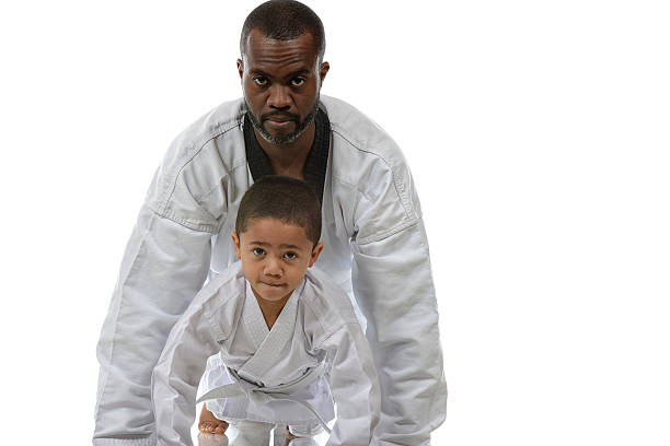 father and son - martial arts gerville stock pictures, royalty-free photos & images