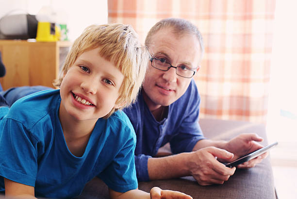 father and son - autism stock photos and pictures