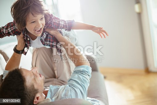 Close up of a father playing with his son.