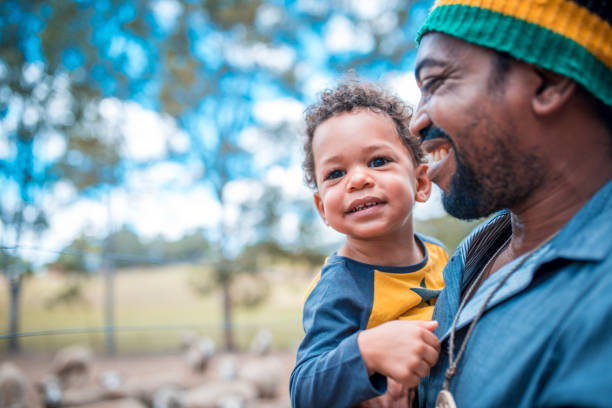 father and son - rural lifestyle stock photos and pictures