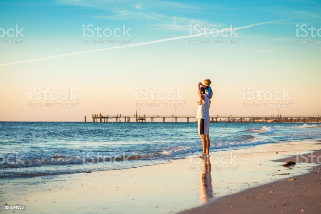 Father and son piggyback stock photo