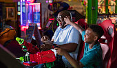 istock Father and son playing amusement arcade game 1311317318
