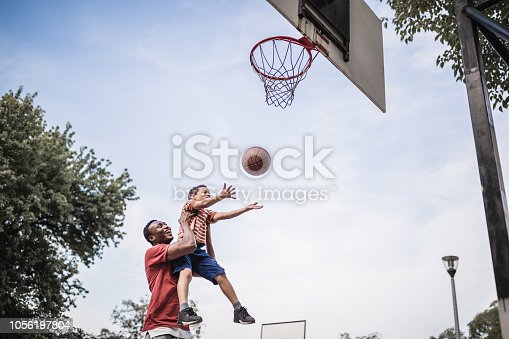 Father and son playing basketball. Belgrade, Serbia
