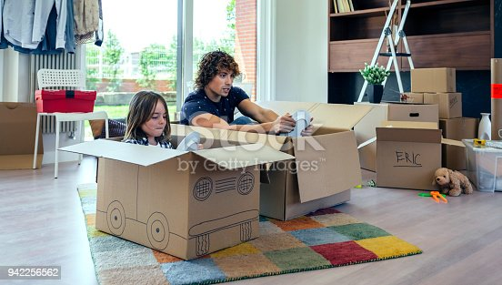 istock Father and son playing car racing with cardboard boxes 942256562