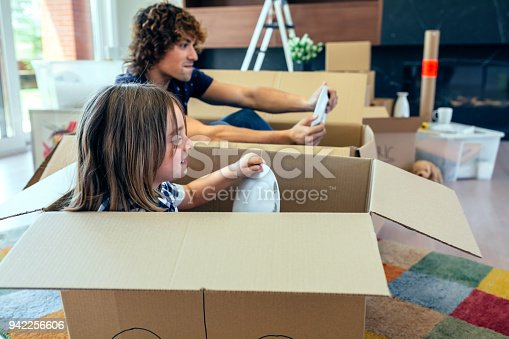 942256562istockphoto Father and son playing car racing with cardboard boxes 942256606