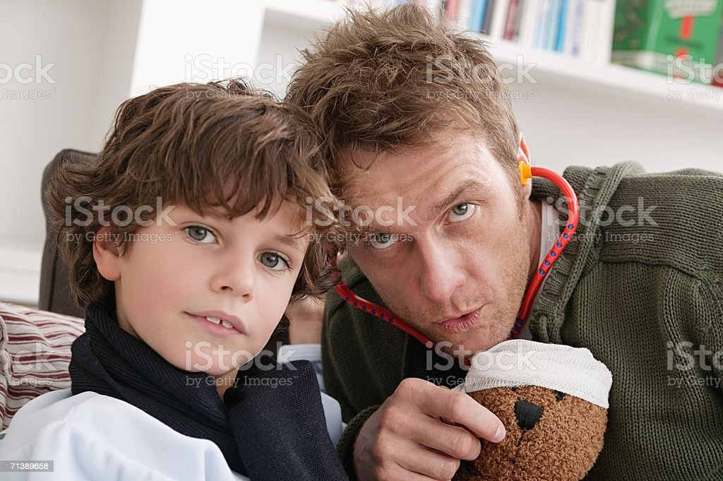 Father and son playing doctors royalty-free stock photo