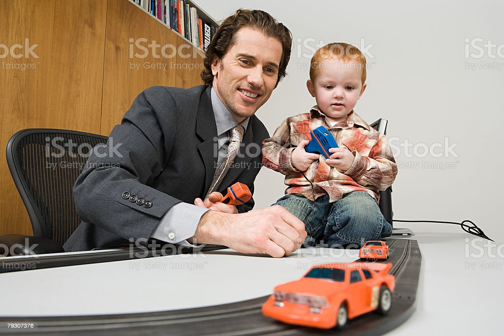 A father and son playing electric shot car royalty-free stock photo