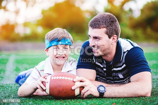 544818734 istock photo Father and Son Playing Football in The Park 481756150