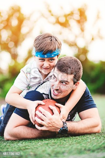 544818734 istock photo Father and Son Playing Football in The Park 481756162