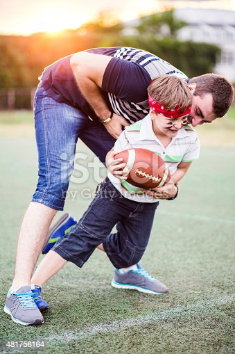 544818734 istock photo Father and Son Playing Football in The Park 481756164