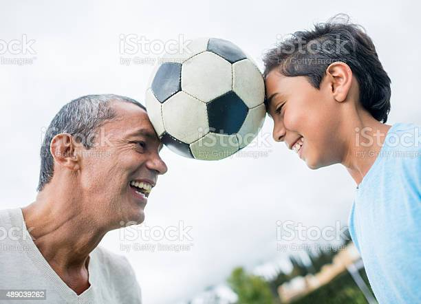 Father and son playing football together picture id489039262?b=1&k=6&m=489039262&s=612x612&h=fkyz92hucu  04vcrypievok55afdgwuhv3afj8kl8o=