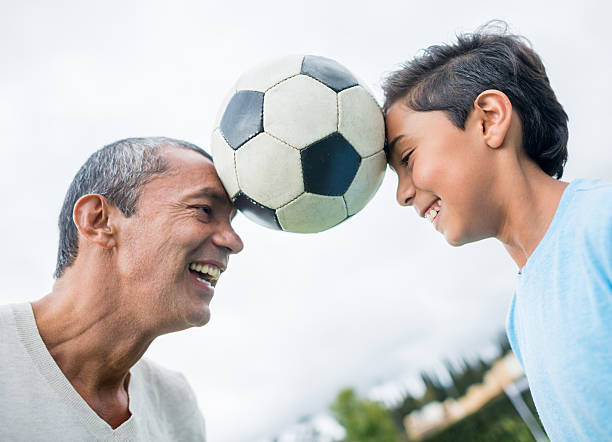 Father and son playing football together picture id489039262?b=1&k=6&m=489039262&s=612x612&w=0&h=c6i18oegde8t2btcphzqmcd4rrjuywa 5rul qvq2ne=