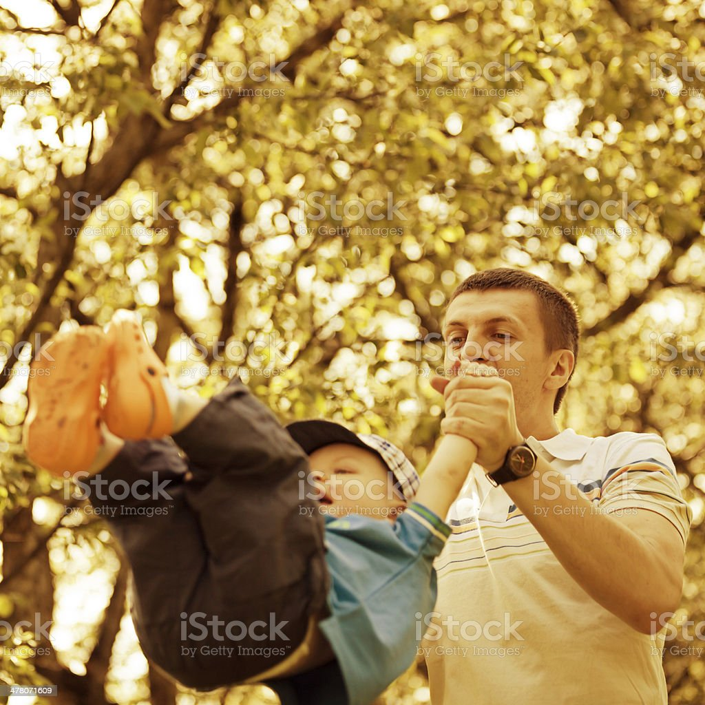 Father and son playing in park royalty-free stock photo