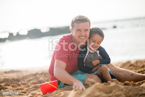 605742160 istock photo Father and Son Playing in the Sand 533431118