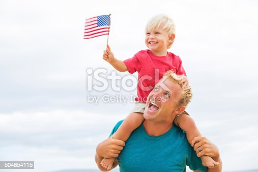 istock Father and son playing on the beach 504854115