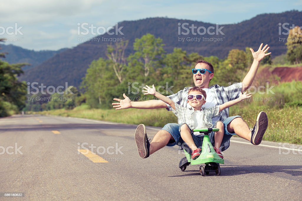 Father and son playing on the road. stock photo