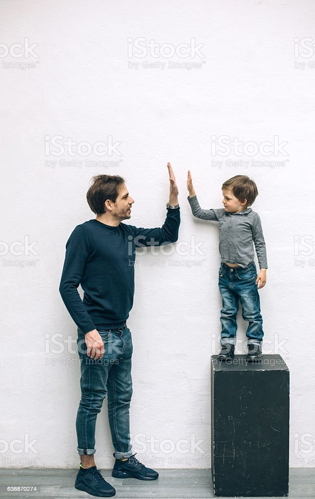Father and son playing stock photo
