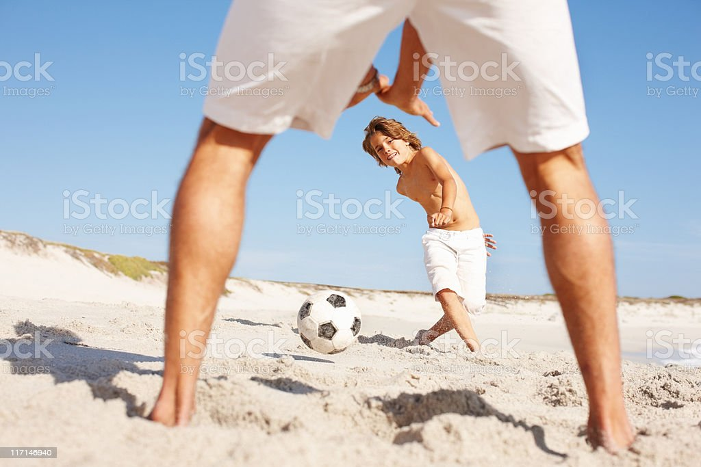 Father and son playing soccer royalty-free stock photo