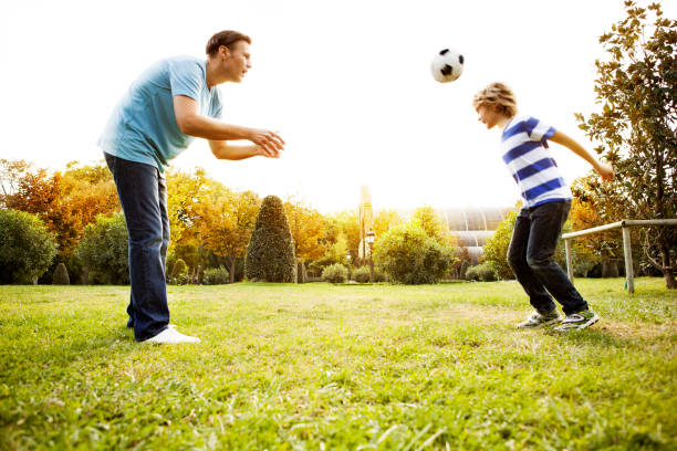Father and son playing soccer picture id188026818?b=1&k=6&m=188026818&s=612x612&w=0&h=ncrep9xrpk1knumwdquuhpeh4  h9axuulcajgjaw4k=