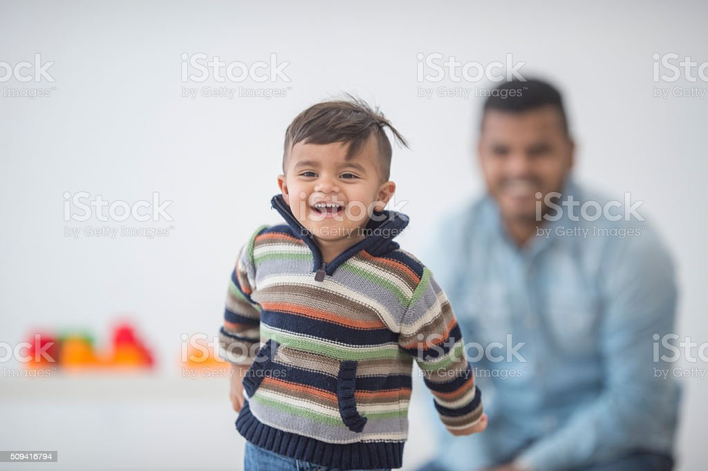 Father and Son Playing Together At Home stock photo
