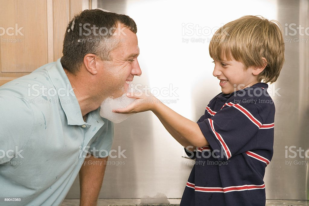 Father and Son Playing With Soap Bubbles royalty-free stock photo
