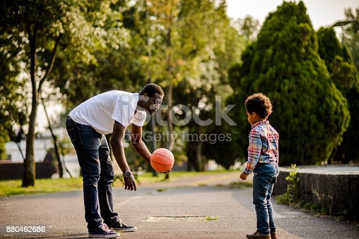 889172928istockphoto Father and son playing with the ball. 880462686