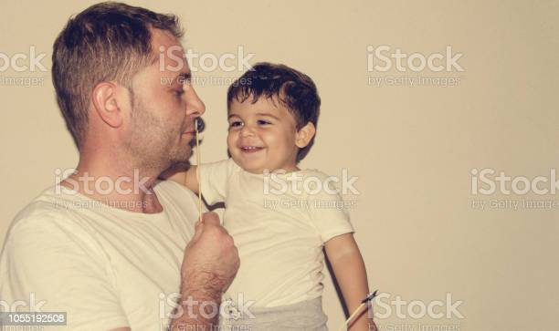 Father and son playng with moustache funny faces picture id1055192508?b=1&k=6&m=1055192508&s=612x612&h=s0mfcq7vtatvkqqtefdpgf4pxrnzrqgvuhebp 8z6my=