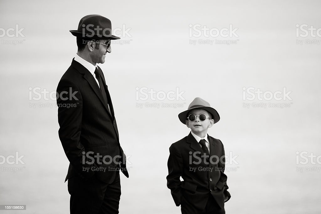 Father And Son Posing In similar Clothes stock photo