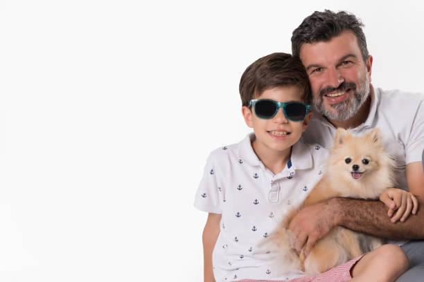 Father and son posing with her dog over white background picture id1001653606?b=1&k=6&m=1001653606&s=612x612&w=0&h=uufha xpknjsr5ce8zxo8eln9zqlpu ixmq4gkzz 4c=