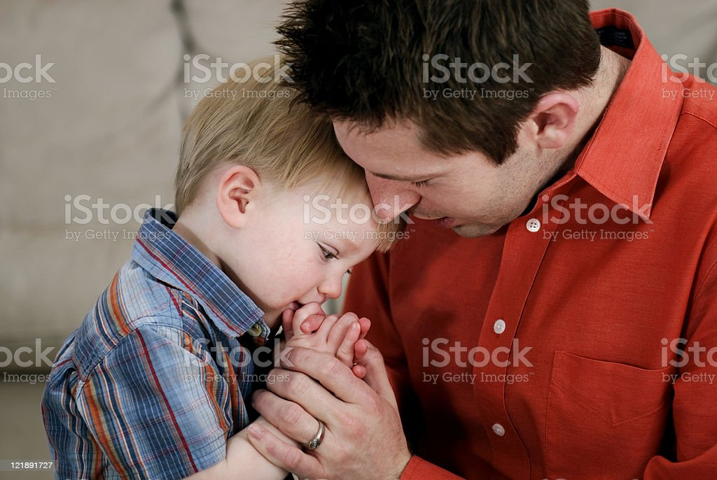 Father and Son Praying Together royalty-free stock photo