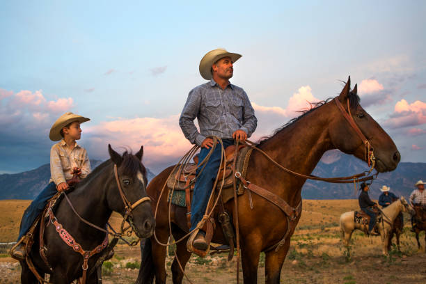 Father and Son Ranchers stock photo