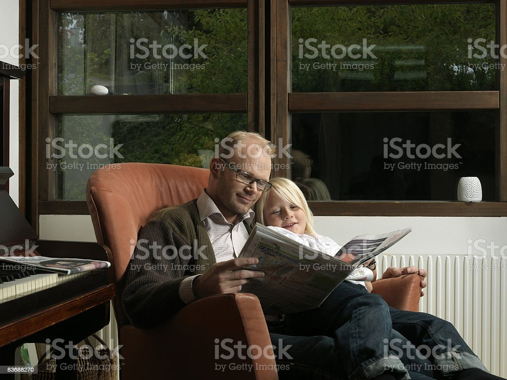Father and son reading paper royalty-free stock photo