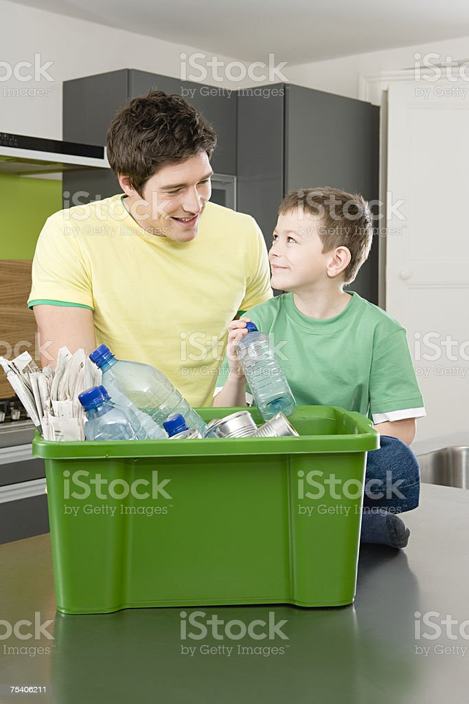 Father and son recycling royalty-free stock photo