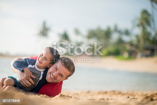 605742160 istock photo Father and Son Relaxing on the Beach 501579948