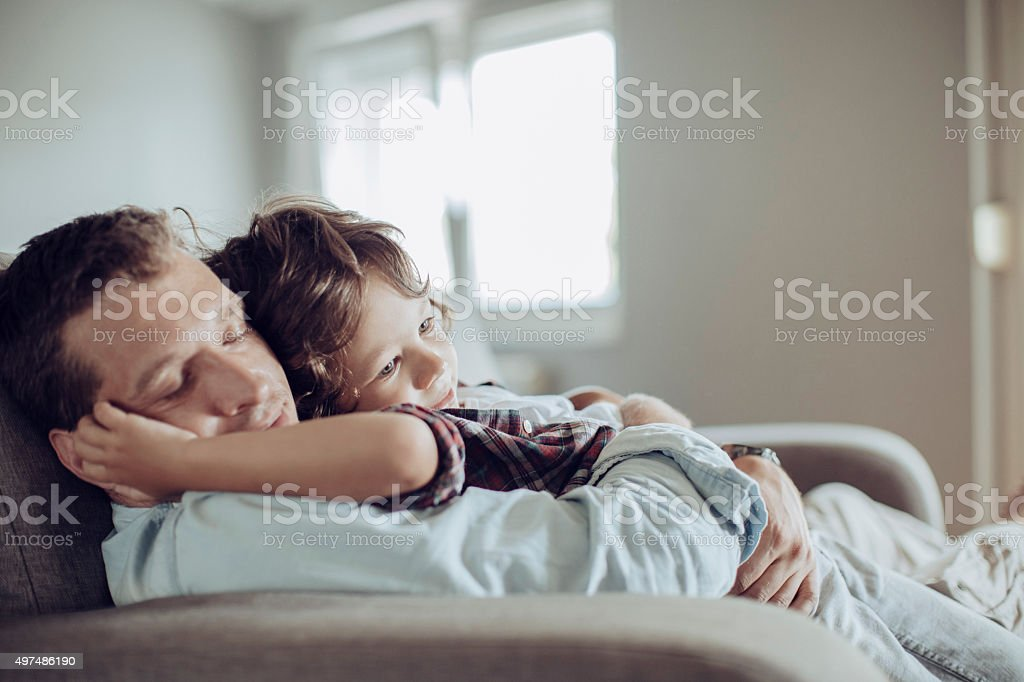 Father and son resting together stock photo