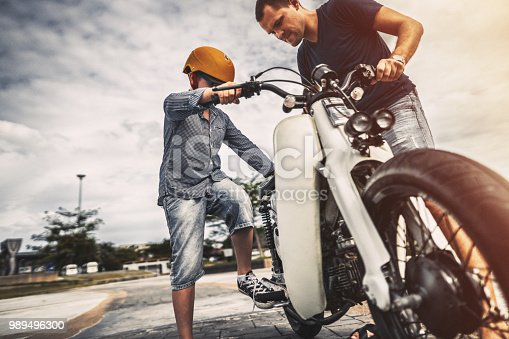Father and son riding a bike