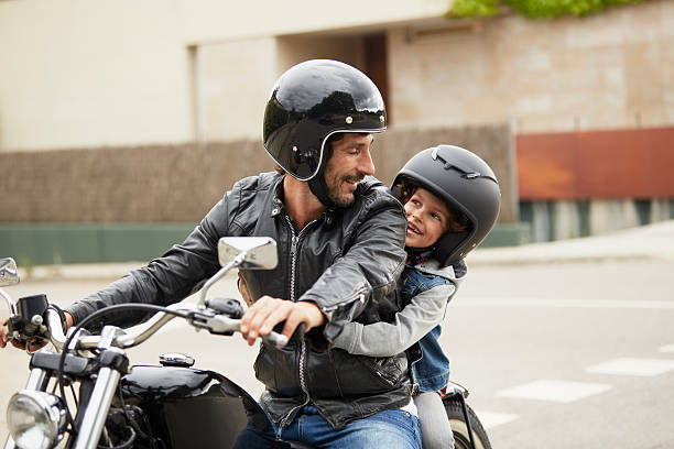 father and son riding motorbike - helmet motorbike imagens e fotografias de stock