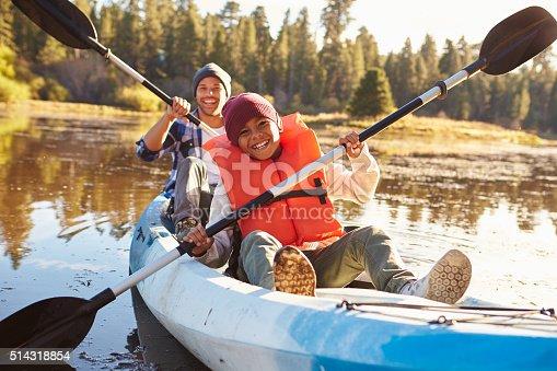 istock Father And Son Rowing Kayak On Lake 514318854