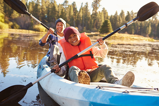 istock Father And Son Rowing Kayak On Lake 514318854