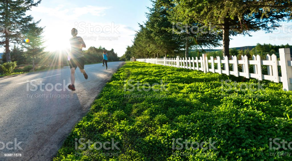 Father and son running in the park stock photo